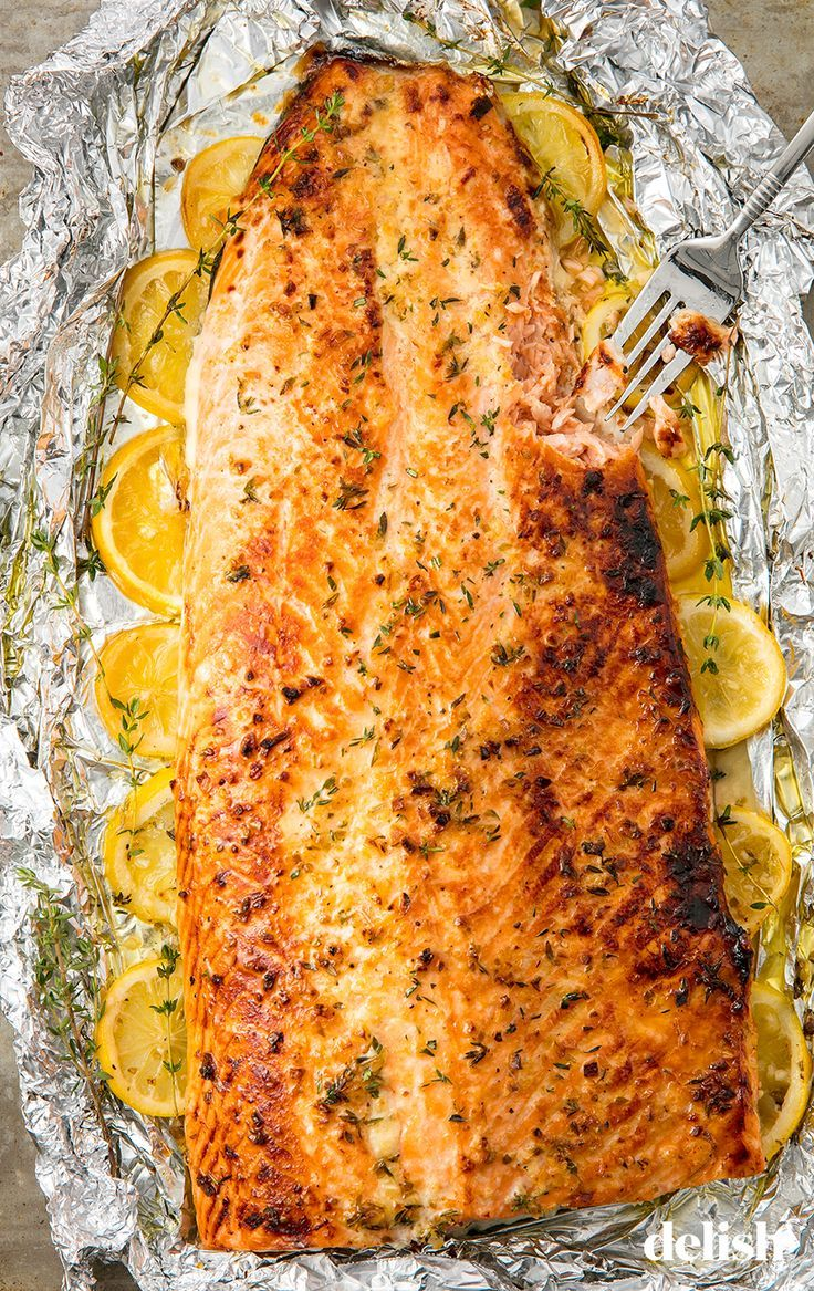 Garlic Butter Baked Salmon The Easiest Way To Feed A Crowd Recipe Baked Salmon Recipes Salmon Fillet Recipes Healthy Baked Salmon