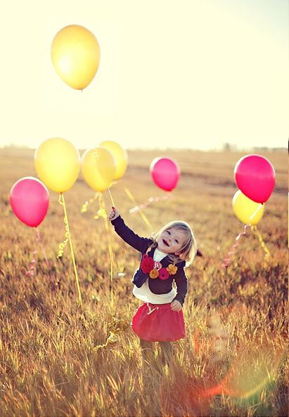 LOVE the balloons in a field. would be a fun birthday pic