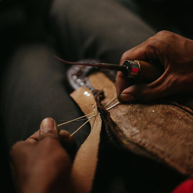 Handwelted Goodyear construction involves two layer of stitching. This picture shows the first layer being stitched, connecting the leather upper to the welt of the sole. The second layer is stitching between the welt and the sole of the shoe. Goodyear construction provides double protection against wear and tear and protects the wearer from external elements.