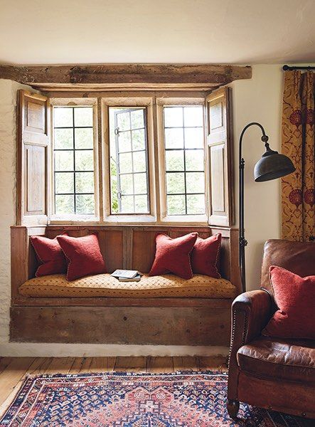 cotswold house renovation wood window shutters seat