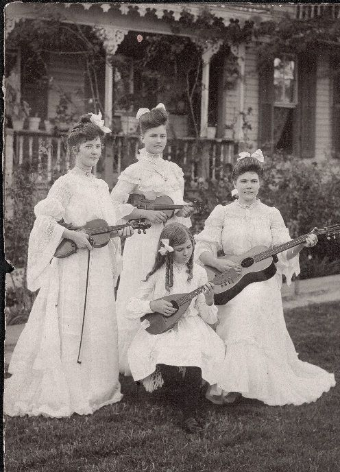 Ellen Hoeffert (holding guitar) and her sisters, circa 1903 in Schulenburg, Texas.