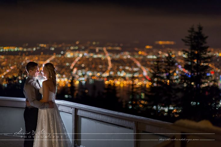 Overlooking the city of Vancouver in the distance with this night photo of a wedding at Grouse Mountain in the winter