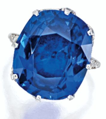 SAPPHIRE AND DIAMOND RING, Tiffany & Co.            Centring on a cushion-shaped sapphire weighing 17.06 carats, to a stylised mount decorated by circular-cut diamonds, mounted in platinum, signed. Sotheby's.
