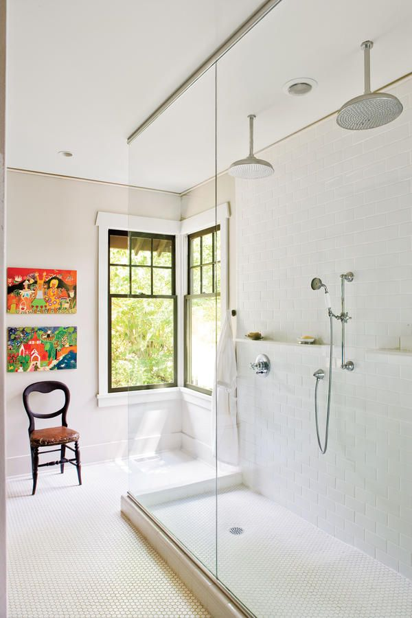 Multiply Shower Fixtures - 65 Calming Bathroom Retreats - Southernliving. Dual overhead showerheads and hand-held sprayer options are the stars of this large and luxurious shower space.