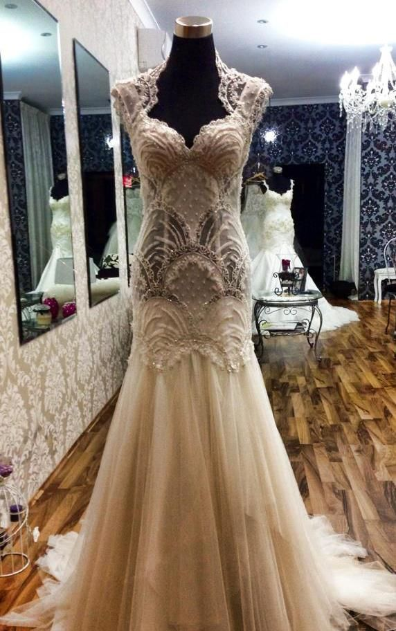 This dress is absolutely stunning! Takes my breath away. Very romantic, love the lace. My dream wedding dress has to have lace on it. Lace to me symbolizes old fashion, class, elegance.