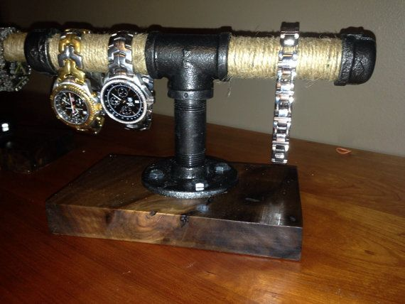 This Jewelry Holder Makes a Great Conversation Piece ~ Hand Crafted ~ Solid Black Walnut Base Measuring 8 by 4 by 1 Thick ~ Walnut Finished With Pure Tung Oil To Bring Out The Great Look Of Wood Grain ~ Piping Treated With A Hammer Tone Finishing Sealer If you would like a