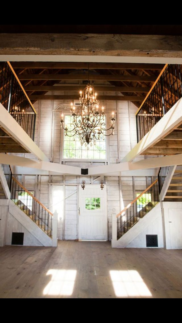 A whitewashed barn with chandeliers...Love!