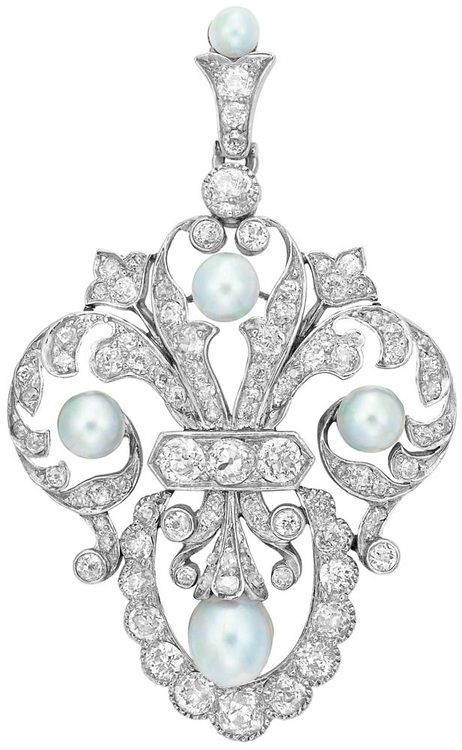 Platinum, Gold, Pearl and Diamond Pendant-Brooch, Marcus & Co.  The stylized fleur-de-lys mount enhanced by 4 pearls approximately 5.6 to 4.5 mm., set throughout with numerous old-mine cut diamonds, with pearl and diamond-set pendant loop, signed M & Co., circa 1905, approximately 9 dwt. Via Doyle New York.