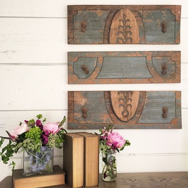 Old Drawer fronts used as art on the wall   Joanna Gaines Fixer Upper Magnolia Market