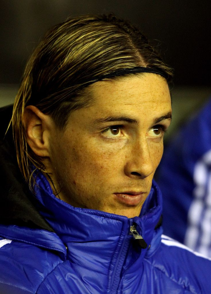 Fernando Torres Photos Photos - Fernando Torres of Chelsea looks on from the bench prior to the Barclays Premier League match between Wigan Athletic and Chelsea at the DW Stadium on December 17, 2011 in Wigan, England. - Wigan Athletic v Chelsea - Premier League