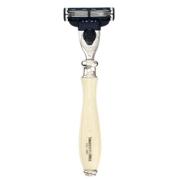 """Carlton Razor. Truefitts """"Carlton"""" style razor with Mach III head. Made in the UK, our specially weighted and ergonomically hand-crafted razor handles are designed to assist in giving you the smoothest, safest shave possible. Available in Faux Ivory or Faux Ebony with a chrome finish."""