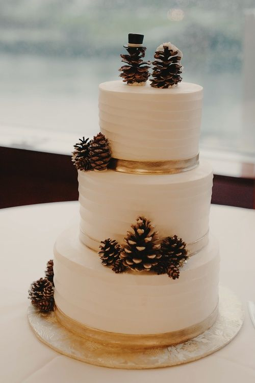 Winter wedding inspiration: pinecone bride and groom cake topper | Kristen Marie Photography