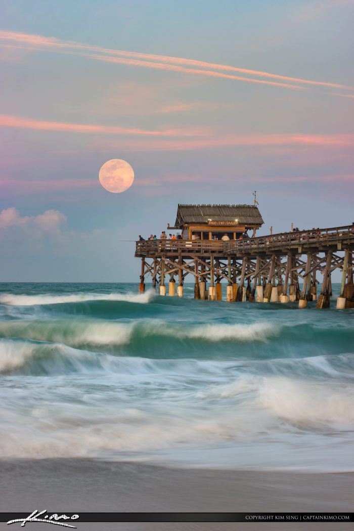 Awesome full moon rise over the Cocoa Beach Pier in Cocoa Beach Florida in Brevard County. HDR image tone mapped using Aurora HDR osftware by Macphun.