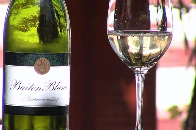 Enjoy Buitenverwachting's Buiten Blanc wine while viewing green horse paddocks and the beautiful old farm manor house.