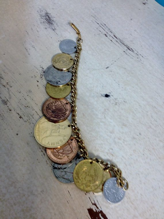 Beautiful vintage coin charm bracelet, with 11 assorted international coins. The coins are dated 1960-66, with one from 1945. They range in size