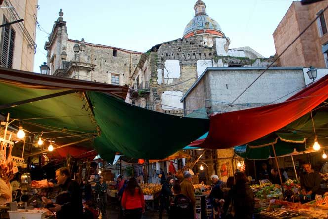 Palermo's Ballarò market is a place that awakens all of the senses.  stands crowded with fresh fish, meat, vegetables, and traditional foods like flour and chickpea fritters.
