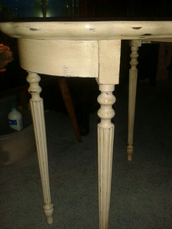 Slightly distressed completed with dark wax close up of the nest of tables