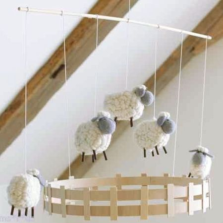 Decorate a gender-neutral nursery with a lamb or sheep theme, woolly lamp mobile