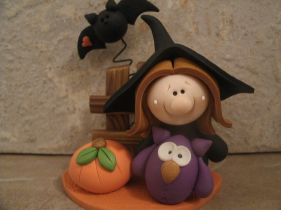 Originally it's a polymer clay Halloween Witch, Owl, pumpkin and bat figure. LOve the cuteness of it