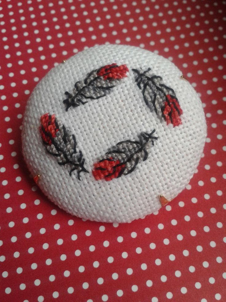 Feather cross stitch brooch http://www.facebook.com/lilybedilly