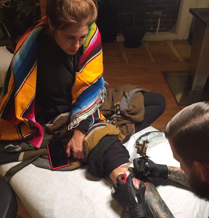Kim Saigh getting a tattoo by special guest Seth Wood at Memoir Tattoo