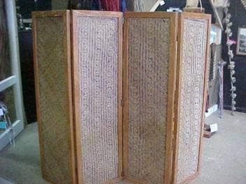 This dividing screen has 4x panels - each frame has been carved with Maori kowhaiwhai/whakairo.