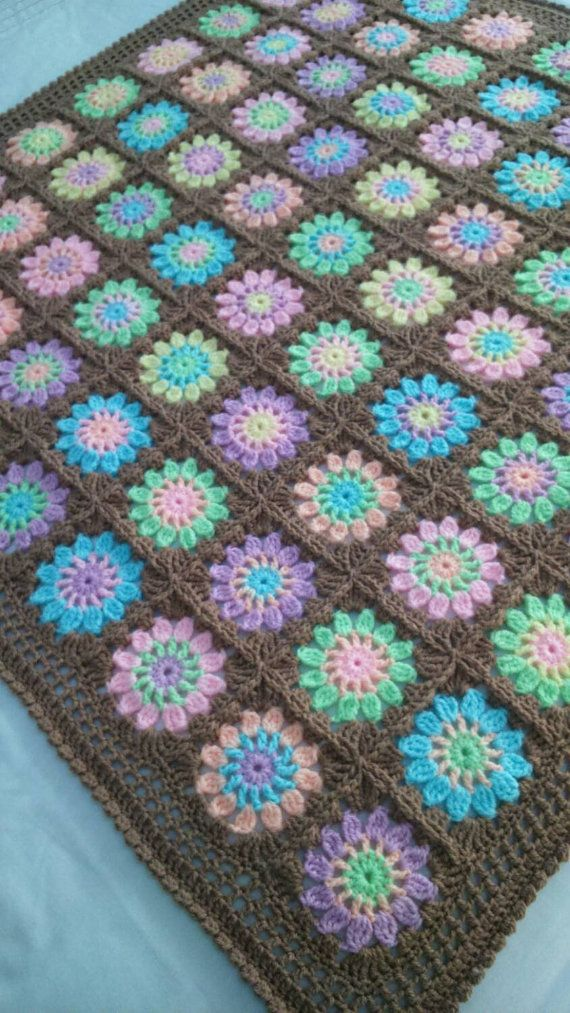A bright pastel crochet blanket ideal for a baby by CrochetMaidUK