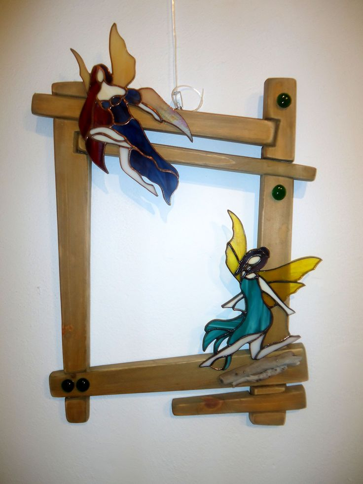 Stained glass fairies in a wooden frame