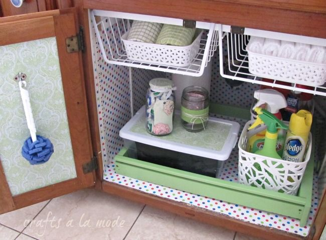 I never thought of attaching those under cabinet racks to the ceiling of cabinet under sink! Might be helpful. | under sink organization idea