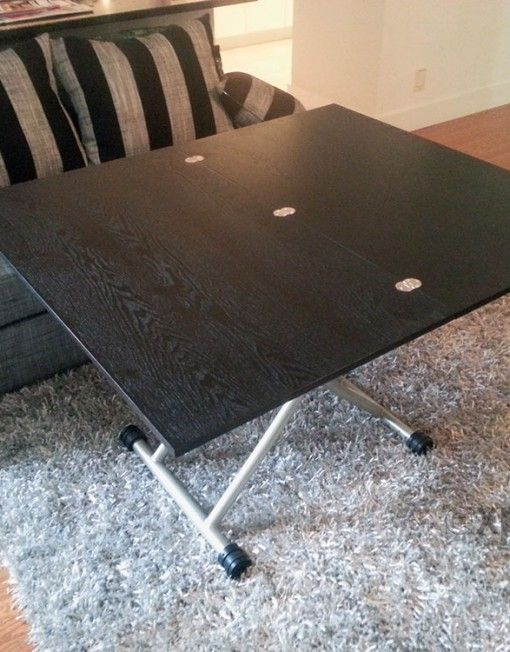 transforming coffee to dining table in black walnut apt
