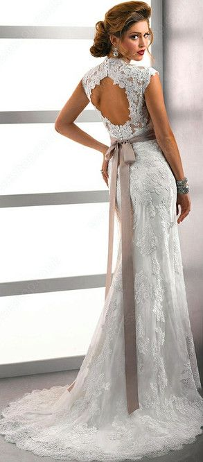 This beauty is at Camarillo Bridal. Lace, keyhole back wedding gown with a sash.