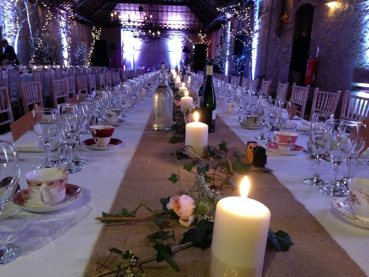 simple hessian table centres with candles, ivy, the odd thistle and rose - from Fridays wedding here at Larchfield. Vintage crockery adds more colour to this stunning table set up...