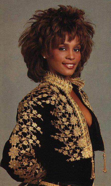 Whitney Houston wearing Marc Bouwer velvet toreador jacket and catsuit