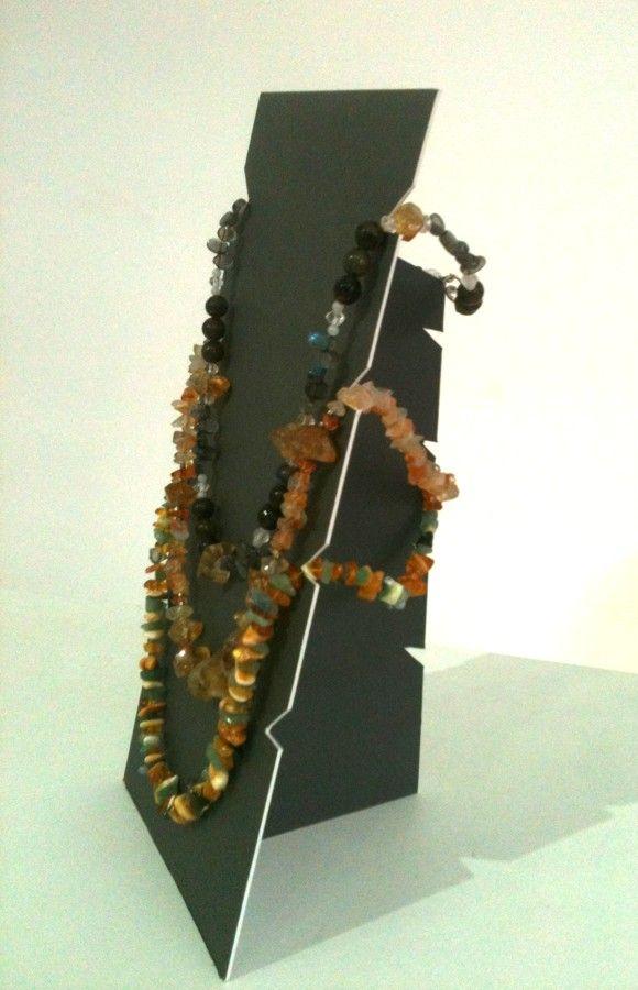 DIY cardboard jewelry display: http://handmadeineurope.com/heymesbalticamber/diy-cardboard-necklace-display/
