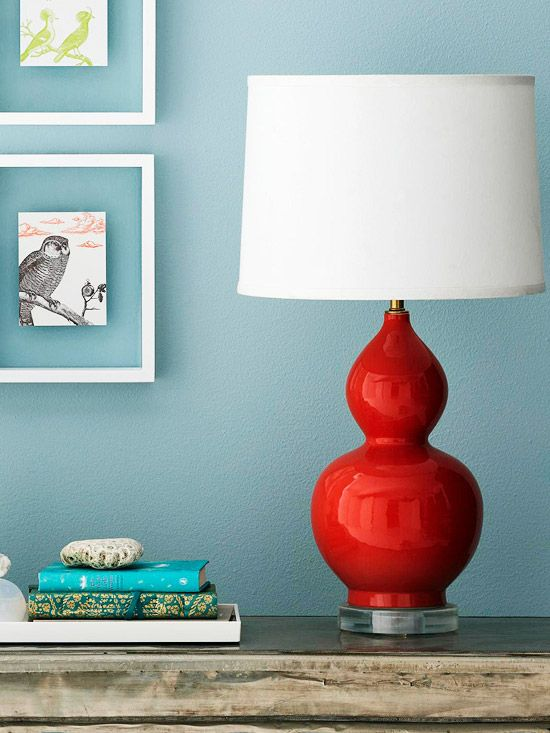 Spray paint an old lamp base with a bold, glossy color; top with an inexpensive lamp shade; trim with grosgrain ribbon.  Inexpensive and unique.