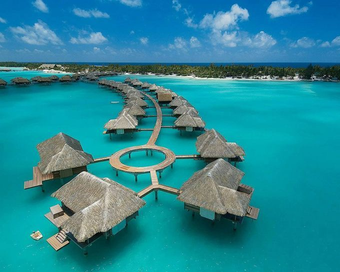 Four Seasons Hotel - Bora Bora.   Cheaper than the Maldives and just as gorgeous.  Honeymoon anyone?
