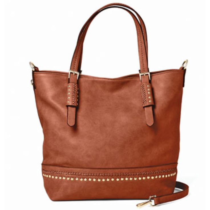 Vegan leather zip tote with embellished accents along the bottom. Spacious interior, dual top handles and detachable strap. Separate gun compartment in back features dual zippers. Includes two holster