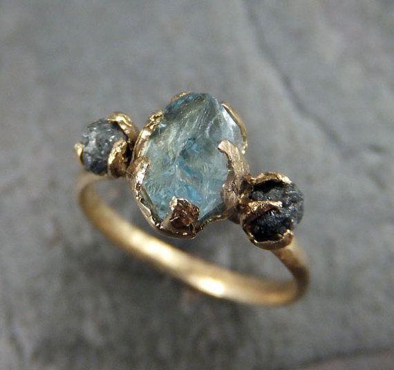 Beautiful, love the raw diamond concept https://www.etsy.com/listing/206537485/raw-uncut-aquamarine-diamond-gold