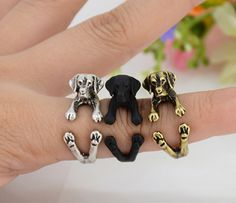 This ring is made in the shape of a labrador retriever that wraps around your finger. They are one size fits all and are plated in silver, bronze and black. This is perfect for anyone looking for uniq