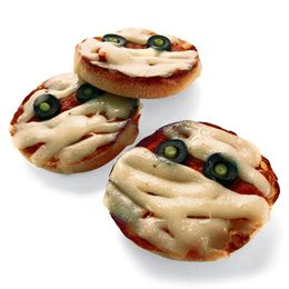 Mini Pizza Mummies - Mozzarella cheese slices cut into strips, pizza sauce, pepperoni or other pizza topping (or no topping other than sauce and cheese), sliced black olives. Directions: Add sauce and topping (if used) to muffin, olives for eyes and lay strips of cheese over the top to create your mummy. Let the kids build their own for some fun family cooking! Bake for about 10 minutes at 350°.