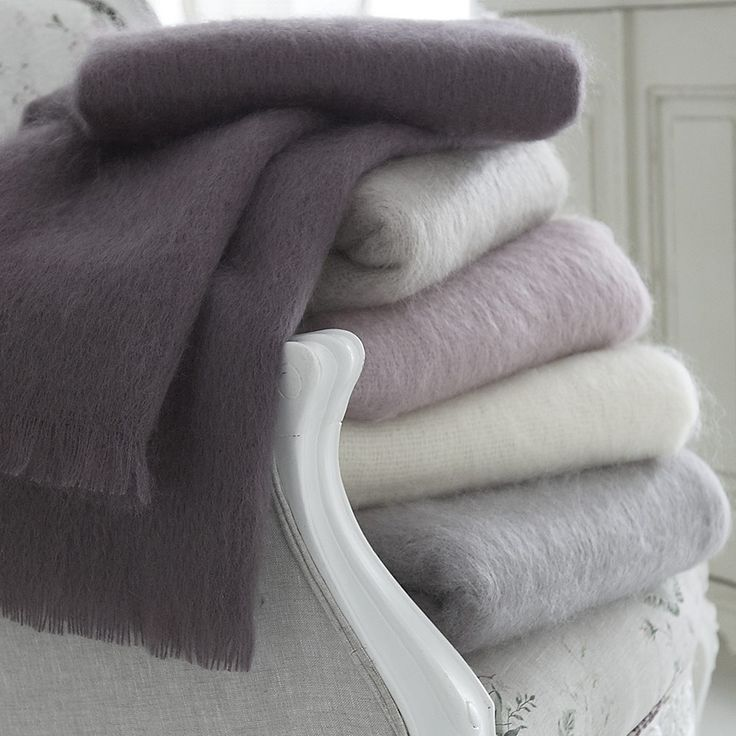 The plum colour throw would look good.   Mohair Throw Soft Natural Colours