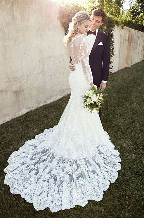 This beautiful lace wedding dress features a timeless illusion neckline, back, and sleeves. Essense of Australia, Spring 2015