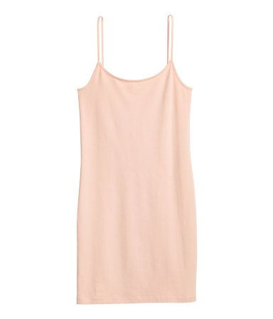 Short, fitted jersey dress with narrow shoulder straps.