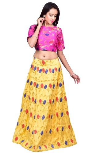 Pink elbow sleeves top in silk brocade. It is paired with lemon yellow paneled skirt in silk brocade