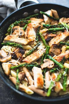 Savory garlic chicken mushroom and asparagus penne with amazing flavor and comes together in just 30 minutes. A healthy, easy spring pasta!