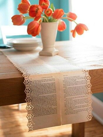 Lace hole punch + book pages (or butcher paper / sheet music) = table runner!