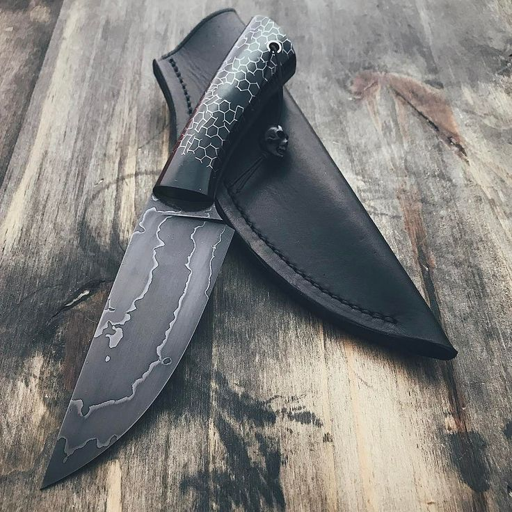 "Finished scout knife with leather sheath. About 9"" overall crazytek scales with black micarta pins and stainless tube."