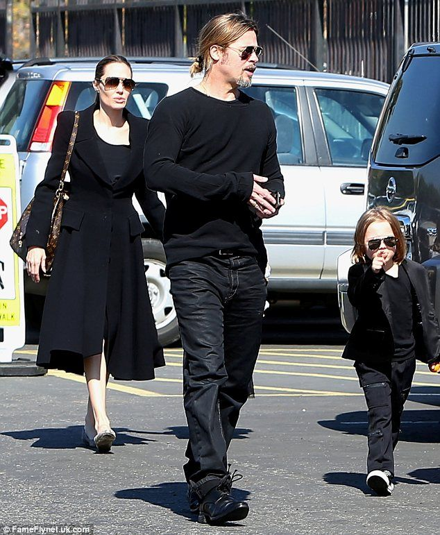 With golden shoulder length hair, a sophisticated black suit and aviator sunglasses, Knox Jolie-Pitt was the spitting image of his father
