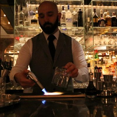 Bartender Starts Fires in the Name of Cocktails | smokey Old Fashioned made with Woodford Reserve bourbon, housemade bitters and simple syrup