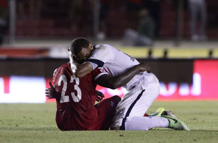 American Terrence Boyd, in white, embraced Panama's Felipe Baloy after the decisive goals. Boyd was in a similar situation last March, when a stoppage-time goal from El Salvador ended the USA's chances at making the 2012 Olympics. No one was there to console him. (AP)